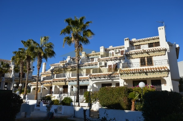 Big townhouse with small garden only 70 m from Cala Capitán beach.