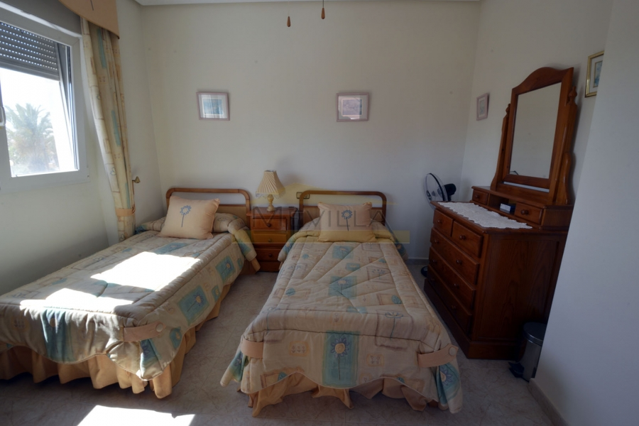 A bedroom with 2 separate beds